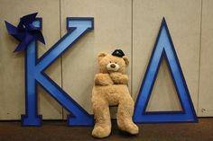 Pinwheels for Prevention letters with our teddy bear
