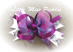 Purple music bow  https://www.facebook.com/pages/Little-Miss-Pickles/220746814757468?ref=hl