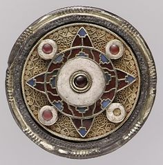 Anglo-Saxon disc brooch from Faversham, England, ca.early 7th century. Gold with garnets, glass, and niello | Metropolitan Museum of Art