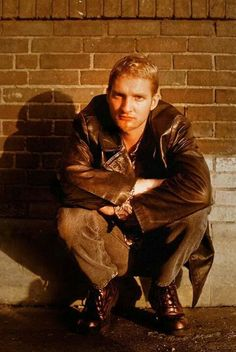 Layne Staley Bricks wall Squat Leather jacket Short hair Photo shoot