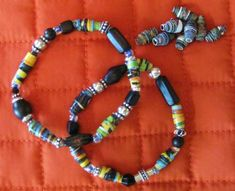 Recycled paper bead bracelets. . . could be interesting to repurpose pages from a worn out book of poems. . . . or newspaper from someone's birthday. . . or anniversary.
