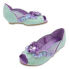 Ariel Costume Shoes for Kids | Disney Store Your Little Mermaid will be excited to walk on land wearing these glamorous Ariel Costume Shoes. An ocean of sparkling pale blue is trimmed in waves of iridescent organza and accented with a large faceted heart jewel.