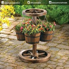 Buy Wagon Wheel Planter at wholesale prices. We offer a large selection of cheap Wholesale Garden Planters. If you need Wagon Wheel Planter in bulk at a discount price then buy from WholesaleMart. Wood Barrel Planters, Rustic Planters, Hanging Planters, Garden Planters, Hanging Baskets, Outdoor Planters, Rustic Outdoor Decor, Rustic Patio, Western Decor