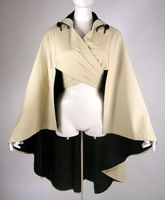 Found this on a blog, who said she'd found it on Pinterest but had no idea where it came from.     I just want an awesome wrap cape.