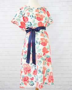Don't want to wear a hospital issued gown for delivery? Bring your own! This adorable coral and navy modern floral gown is the same size as the hospital's but has snaps all the way down the back for full coverage and nursing snaps at each shoulder.