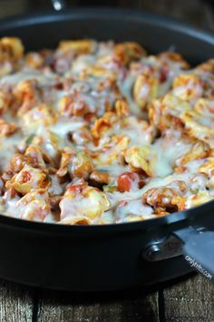 Sausage Tortellini Skillet - hearty, tasty and just under 300 calories or 9 Weight Watchers SmartPoints per serving! www.emilybites.com