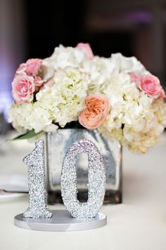 Silver glitter table numbers | Lindsay and Kevin's winer wonderland wedding: http://www.xaazablog.com/boston-winter-wonderland-lindsay-kevin/ Photography: Rachel Red Photography #winterwedding #bostonwedding
