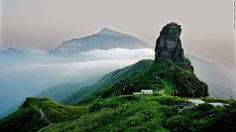 Often shrouded in mist, this holy Buddhist mountain is located in northeast Guizhou and home to rare plant species and animals including the seldom glimpsed golden monkey. On clear days, the summit offers stunning views.