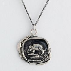 Elephant Talisman Necklace    This handcrafted talisman necklace features an elephant, which is symbolic of good luck and wisdom.