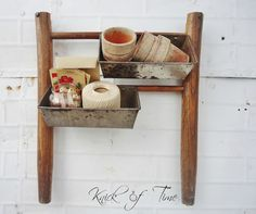 Old chair legs, old bread pans, really cute storage bins