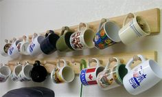 I did this a long time ago in one of my apartments.works well for coffee mug storage Coffee Cup Storage, Mug Storage, Coffee Mug Display, Coffee Shop, Wall Storage, Coffee Cups, Wooden Coat Hooks, Diy Kitchen Decor, Kitchen Ideas