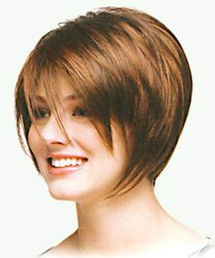A tapered geometric bob with LONG slivered bangs.