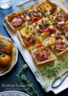 with Pesto & Onions Beautiful tomato tart with goat cheese, yum. From White on Rice Couple, and of course gorgeous photos.Beautiful tomato tart with goat cheese, yum. From White on Rice Couple, and of course gorgeous photos. Tomato Tart Recipe, Pesto Recipe, Tomato Pie, Feta Cheese Recipes, Appetizer Recipes, Brunch Recipes, Quiches, Heirloom Tomato Tart, Gourmet