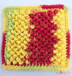 "Free Pattern: Tunisian Pebbles Dishcloth - moogly Do you see the way the little red and yellow ""pebbles"" pop up on the surface? They're framed by lines of green, creating a tiny little garden! Get in close and it's like a whole little world of flowers. This dishcloth makes me so happy! And it's a cinch to make too. All you need to know are the basics of Tunisian crochet"