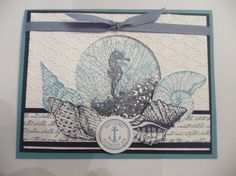 Shaker card-by the tide/by the seashore  by Kim Ransom,   Used the shaving cream technique for the stamped layer and then made it into a shaker card. used the retired glass glitter for the inside. colors used in shaving cream: marina mist and soft sky color inks: night of navy and marina mist