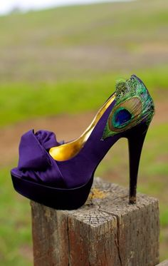 Purple shoes with peacock feathers.