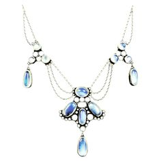 Elegant and graceful moonstone and silver necklace will catch the light and shimmer in various shades of pale blue. England, circa 1890