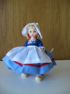 Madame Alexander 8 inch doll.  Holland was my favorite her shoes were real wood and they came off, she also had a small wicker basket.