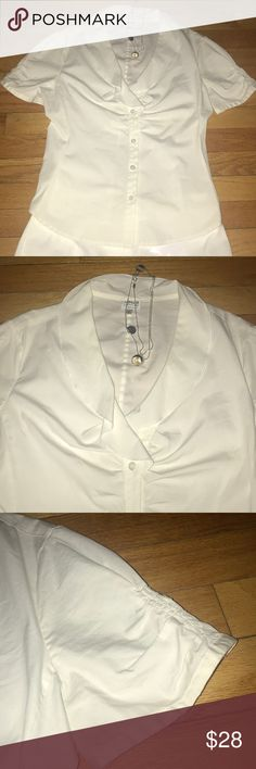 EUC ARMANI COLLEZIONI SHORT WHITE CAP SLEEVE TOP ABSOLUTELY STUNNING EUC WHITE SHORT SLEEVE BLOUSE WITH SMALL GATHERS ON THE SLEEVES AND SO ARMANI NECKLINE - fold over flat collar . THIS IS AN ABSOLUTELY TIMELESS BLOUSE - JACKIE O STYLE . Love it with white shorts( I have some fantastic Dior ones)or white capris or throw some summer color in . Soft beautiful cotton - EVERYONE NEEDS A CLASSIC WHITE BLOUSE IT MAY AS WELL BE ARMANI COLLEZIONI AT THIS PRICE Armani Collezioni Tops Blouses