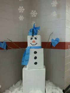 Giant snowman I made at school. Its just large boxes wrapped in paper. Even the hat, scarf and mittens are made of paper.