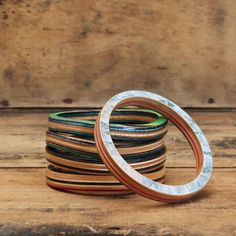 MapleXO's Classic Bangle is one of our original and most popular products. It highlights the graphic along with the inner plies of the skateboard. Just like all of our jewelry, each bangle is one of a