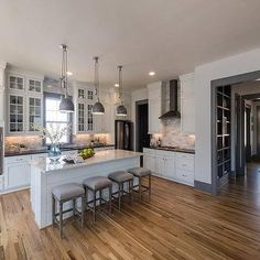 Shiplap Center Island with Backless Gray French Counter Stools