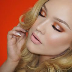"""Video on these warm toned smokey eyes is now up on my YOUTUBE channel  Check it out (direct link in bio)  I used @makeupgeekcosmetics """"Cocoa Bear"""" & """"Peach Smoothie"""" on the crease. For the pop of orange I used @anastasiabeverlyhills """"Orange You Fancy"""" and that highlight on the center is @makeupgeekcosmetics foiled eyeshadow in """"In the Spotlight"""". My liner is @anastasiabeverlyhills """"Vamp"""" Liquid Lipstick. Lashes are @houseoflashes """"Temptress"""" lashes."""