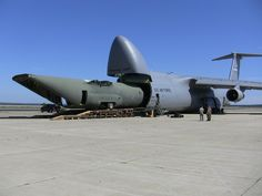 A big Lockheed eating a little Lockheed - C-5 Galaxy and C-130 Hercules cargo planes.
