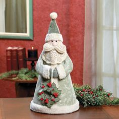 Santa with Holly Wreath. Santa is ready to spread Christmas cheer as he decorates your home for the holidays. Our cone-shaped Santa wears sage green c. Christmas Home, Christmas Holidays, Christmas Decorations, Xmas, Christmas Ideas, Creative Crafts, Diy And Crafts, Holly Wreath, Holiday Crafts