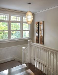 The beautiful architectural details in this stairwell are enhanced by the contrast between the beige walls and the white trim.