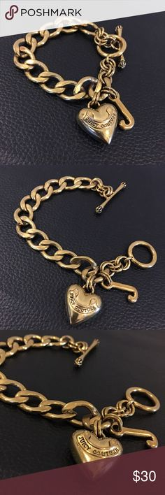 """JUICY COUTURE gold tone large link charm bracelet Lovely JUICY COUTURE gold tone large link charm bracelet with toggle closure. Except for scratching on the reverse side of the heart the bracelet is in great preowned condition. Measures shy of 8"""". Please ask any questions you may have before purchasing. 🚫Trades, 🚫Low ball offers please.  See matching necklace. Juicy Couture Jewelry Bracelets"""
