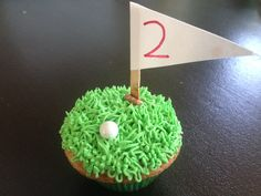 Cupcake by Tamra's Temptations. Golf cupcakes for a very special 2 year old boy's sports balls theme birthday celebration. Golf ball is a shimmery sixlet. Flag is just a coffee stirrer and paper. So many ways to personalize this flag! Grass frosting is a finishing touch. 8/2014 #coffeestirrers