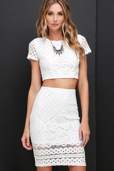 """Grab a partner and strut your stuff in the Graceful Dancer Ivory Lace Two-Piece Dress! Elegant ivory lace in lattice and floral patterns covers a short sleeve crop top, with rounded neck, and darting. Pair with the matching high-waisted pencil skirt with a sheer hem and kick pleat. Exposed silver back zippers with clasps. Small top measures 15"""" long. Small bottom measures 23"""" long."""