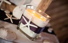 Wedding candles and seashells are ideal centerpieces for beach weddings. ColemanShots http://www.outerbanksweddingassoc.org/membersearch/memberpage.html?MID=1840=Photographers=16 #weddingcandle #centerpieceideas