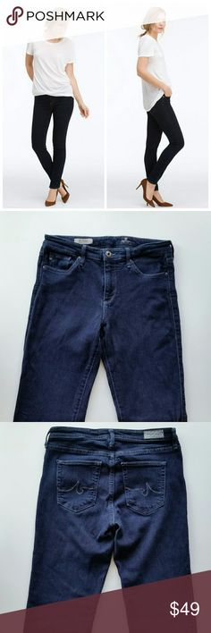 """AG The Prima Mid Rise Cigarette Jeans AG Adriano Goldschmied The Prima Mid Rise Cigarette Jeans  *Size 28 Regular - Waist : 14"""" flat / Inseam : 30"""" *29% Cotton / 69% rayon / 2% PU - Super soft fabric. Similar thickness of denim but very soft and feels more like jersey-ish. Fabric has good stretch. *Mid Rise / Cigarette fit / Dark wash  *In great pre-loved condition with normal signs of wear. No major flaws. *No trade AG Adriano Goldschmied Jeans Straight Leg"""