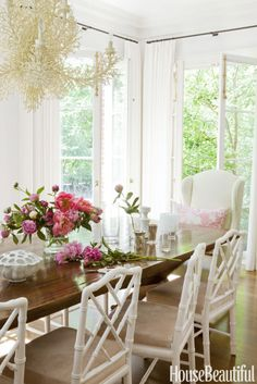 This Is How to Use Pink in Your Home Without Going Too Saccharine : In the breakfast nook, white linen curtains and white-painted chairs and trim were used to brighten the dark wood table and floors. Click through for more ways to use pink in your home! Wood Table, Table And Chairs, Desk Chairs, Room Chairs, Rooms Ideas, Chippendale Chairs, Beach House Decor, Home Decor, Beach Houses