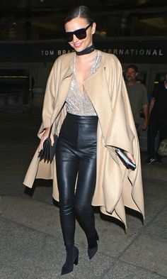 Fall Outfit Ideas: What to Wear With Leggings - Miranda Kerr in high-waisted leather pants, a low-cut velvet top and camel coat and choker