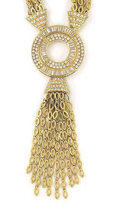 A DIAMOND-SET PENDANT NECKLACE with diamond capped tassel