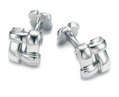 Tiffany and co Cufflinks Cross Shaped Fine Silver jewelry This Tiffany Jewelry Product Features: Category:Tiffany And Co Cufflinks Material: Sterling Silver Manufacturer: Tiffany And Co Wearing Tiffany Cufflinks can make a formal shirt become sophisticated, and is a great way for men to show off their glamour.Tiffany Cufflinks are an accessory that men don't often have to deal with.