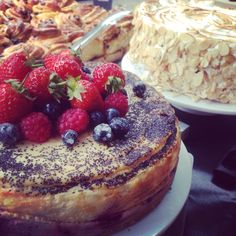 Baked berry cheesecake, lemon and almond meringue cake, and sticky buns