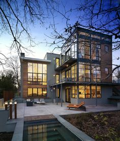 Back patio and rear of house. Lakefront Residence, by Moore Architects. Falls Church, Virginia. #patio #exterior
