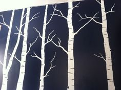 A mural I hand sketched and painted of birch trees on our newly renovated living room wall.