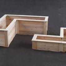 Define courtyard space with planter boxes