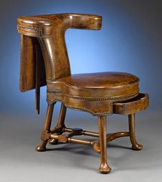 George II Walnut George II Walnut Reading/Cockfighting Chair  England  Circa 1740  Ghastly sport but beautiful chair.