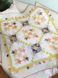 Charm pack pattern by Carried Away Quilting called Purely Petals; Charm Pack Quilt; Scrappy Quilt; Coney Island fabric by Fig Tree for Moda