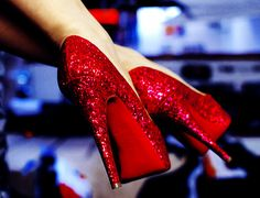 Red loubs - holy freaking crap! This is my dream. One day I will have the sparkly red Dorothy shoes that my mon never bought for me.