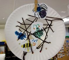 Spiders Web, paper plate, punch holes, thread wool through, add mini-beasts