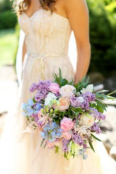 gorgeous spring bouquet with peonies, garden roses, lilacs, astible, and delphinium | Mary Rosenbaum