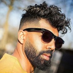 High Fade with Messy Curly Hair and Beard
