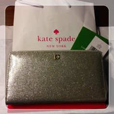 [kate spade] Mavis Street Neda Silver Glitter An absolutely beautiful, super sparkly wallet that has tons of space for your credit cards, cash, and all those loyalty cards you've racked up over the years. I purchased this directly from kate spade and carried It ONCE to a wedding (the one where I wore that gorgeous red chiffon dress also for sale in my closet! ). I still have the tags. This beauty is in perfect condition, you cannot even tell it's been used at all! kate spade Bags Wallets